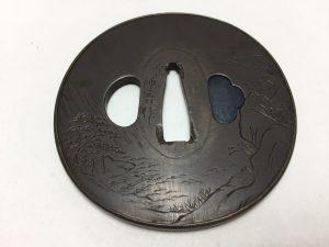 【刀装具・鍔】石山師香 山水図丸鍔を買取致しました。