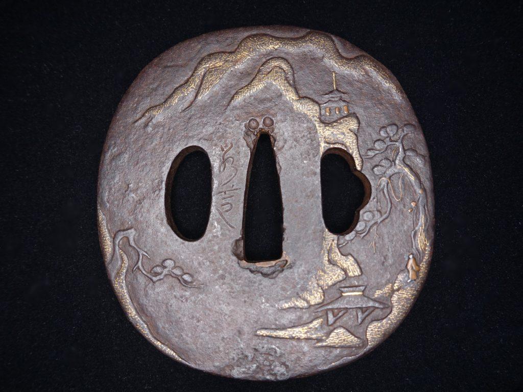 【刀剣・刀装具・鍔】鉄地山水楼閣図象嵌楕円鍔を買取致しました。