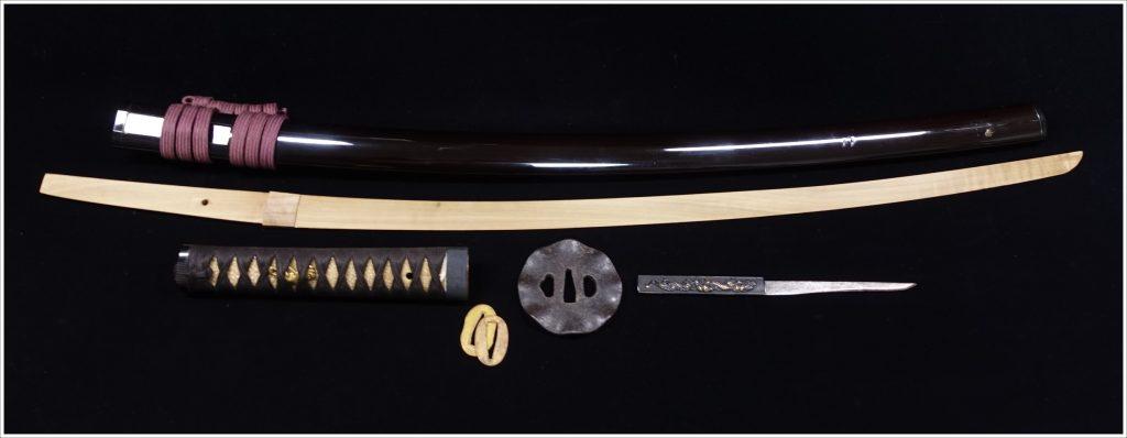 【刀剣・刀装具その他】無銘 「双龍獅子象嵌円形変鍔茶鞘 拵・竹光」を買取り致しました。
