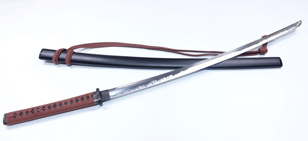 【刀剣・刀装具その他】無銘「黒石目塗鞘 模造居合刀」を買取り致しました。
