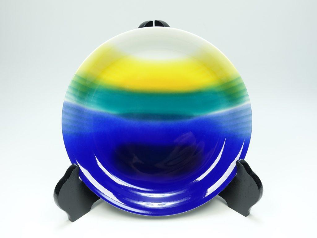 【人間国宝・帝室技芸員】三代 徳田八十吉「圓山窯 採釉旭光色絵皿」を買取り致しました。